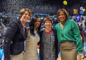 Assistant coaches Beth Cunningham, Niele Ivey; head coach Muffet McGraw; associate head coach Carol Owens. Photo courtesy of Notre Dame Athletics.