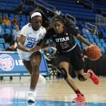 Erika Bean is guarded by Michaela Onyenwere. Maria Noble/WomensHoopsWorld.