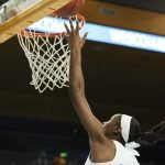 Kennedy Burke almost dunks. Maria Noble/WomensHoopsWorld.