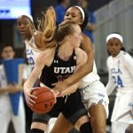 Dru Gylten is guarded by Lajahna Drummer. Maria Noble/WomensHoopsWorld.