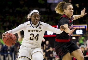 Arike Ogunbowale and Notre Dame squared off against Mykassa Robinson and Louisville in January. AP stock photo.