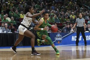 Satou Sabally rolls by Anriel Howard and into the paint. Photo courtesy of Oregon Athletics.