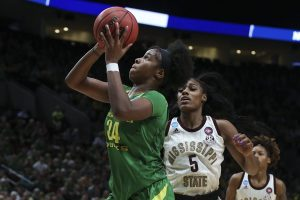 Ruthy Hebard runs past Anriel Howard to score. Photo courtesy of Oregon Athletics.