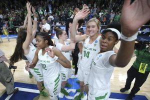 Oregon players wave to their fans after Friday night's Sweet 16 win. Photo courtesy of Oregon Athletics.