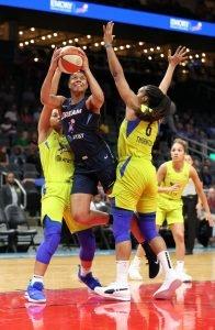 Nia Coffey ascends to score. Brian Savage Photo.