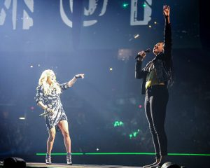 Fever forward Erica McCall raps on stage with Grammy Award winner Carrie Underwood. Photo courtesy of the Indiana Fever.