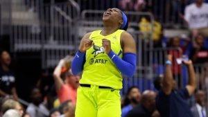 Arike Ogunbowale exults after a shot. NBAE via Getty Images.