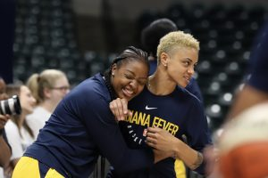"Stephanie Mavunga playfully hugs Candice Dupree, whom younger Fever players refer to as ""Mama Candice."" Kimberly Geswein photo."
