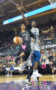 Jordin Canada goes up against Sylvia Fowles. She finished with a team-high 14 points in Seattle's win over the Minnesota Lynx. Neil Enns/Storm Photos.