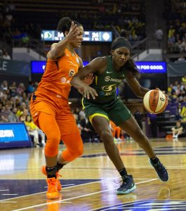 Alyssa Thomas, who finished with a team-high 22 points and 11 rebounds for the Sun, guards Crystal Langhorne, who had 12 points for the Storm. Neil Enns/Storm photos.