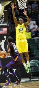 Natasha Howard jumps to defend the basket. Neil Enns/Storm photos.