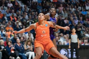Connecticut Sun forward Brionna Jones (42) boxes out Los Angeles Sparks forward Chiney Ogwumike (13) during the WNBA Semi-Finals between the Los Angeles Sparks and the Connecticut Sun at Mohegan Sun Arena, Uncasville, Connecticut, USA on September 17, 2019. Photo Credit: Chris Poss