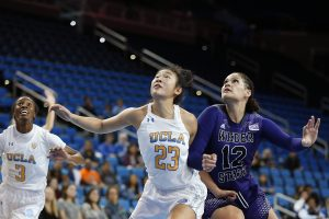 UCLA and Weber State players battle for the rebound. Maria Noble/WomensHoopsWorld