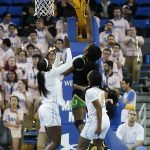Ruthy Hebard goes up for two points. Maria Noble/WomensHoopsWorld.