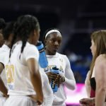 The Bruins huddle at a timeout. Maria Noble/WomensHoopsWorld.