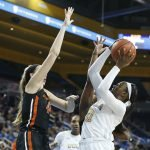 Michaela Onyenwere goes up for a shot against Taylor Jones. Maria Noble/WomensHoopsWorld.