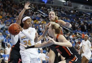 Japreece Dean looks to pass out of the defensive trap. Maria Noble/WomensHoopsWorld.