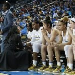 Assistant coach Shannon Perry has words with the UCLA bench. Maria Noble/WomensHoopsWorld.