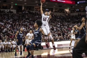 Tyasha Harris sails over the UConn defense and puts up a shot. Photo courtesy of South Carolina Athletics.