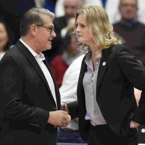 UConn coach Geno Auriemma and Tennessee coach Kellie Harper talked before their teams faced each other in January for the first time in 13 years. AP photo.