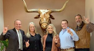 Vic Schaefer and his family at Texas. Photo via Chris Del Conte Twitter.