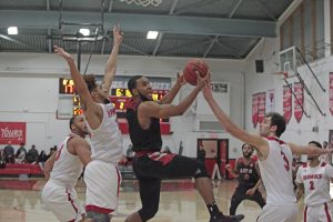 Dante Williams goes for a tough layup. Photo courtesy of Art U Athletics.