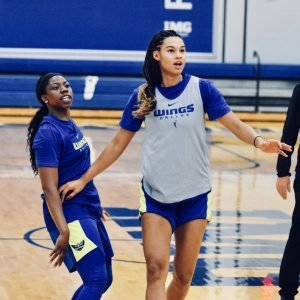 Arike Ogunbowale and Satou Sabally watch to see if a shot falls in practice. Photo courtesy of Dallas Wings.