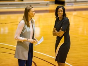 Chandler McCabe and Vanessa Blair-Lewis consult at a timeout. Photo courtesy of Bethune-Cookman Athletics.