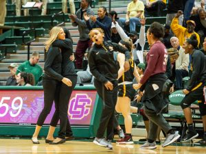 Head coach Vanessa Blair-Lewis hugs associate head coach Chandler McCabe after a big win last December. Photo courtesy of Bethune-Cookman Athletics.